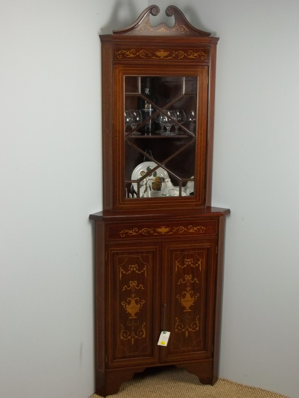 a mahogany edwardian marquetry inlaid two piece standing double height corner display glazed cabinet cupboard c1900