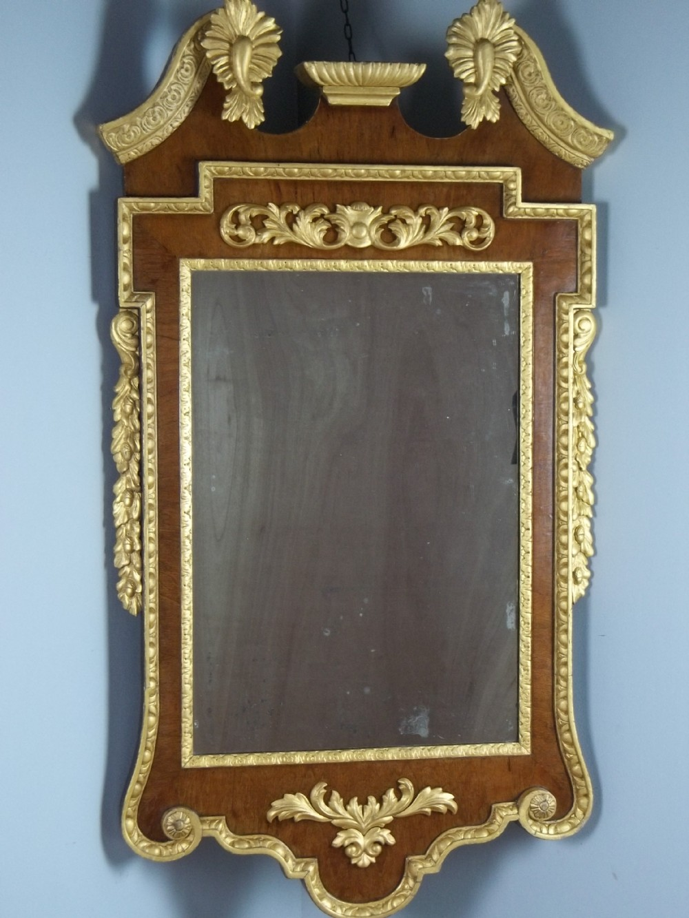 a large 18th19th century walnut and gilt wood fret wall pier console mirror of william kent design c1880