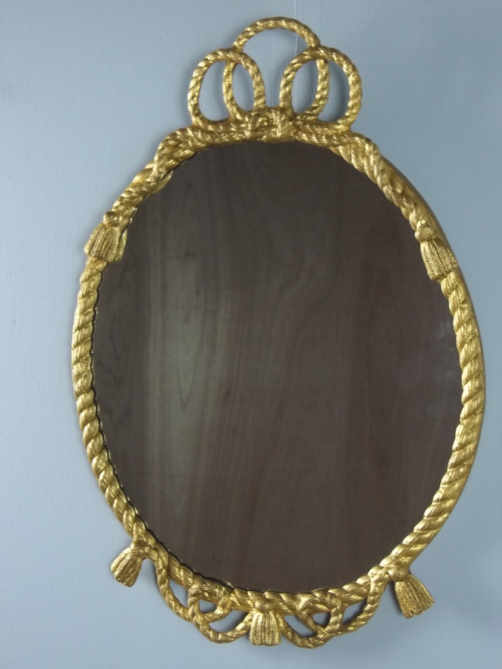 a victorian 19th century english gilded oval rope twist gilt wood wall mirrorc1880