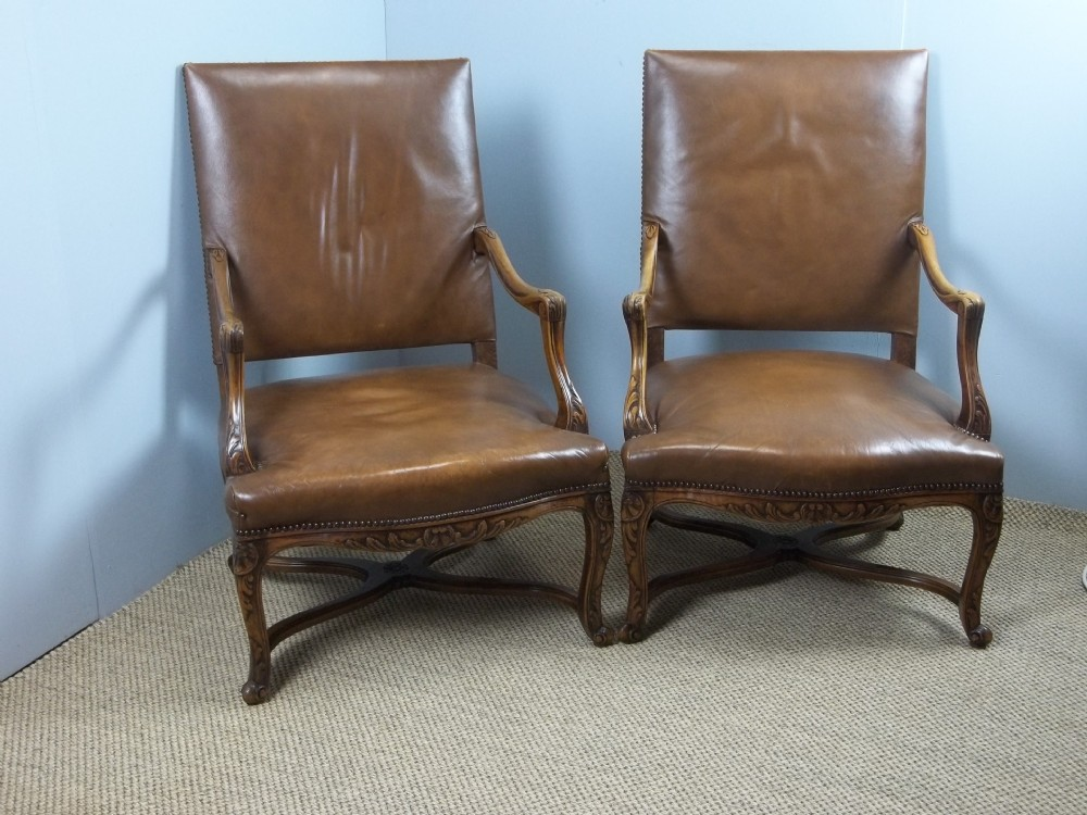 a fabulous pair of leather upholstered 19th century walnut framed gainsborough french fauteuil easy open elbow library reading armchairs c1890