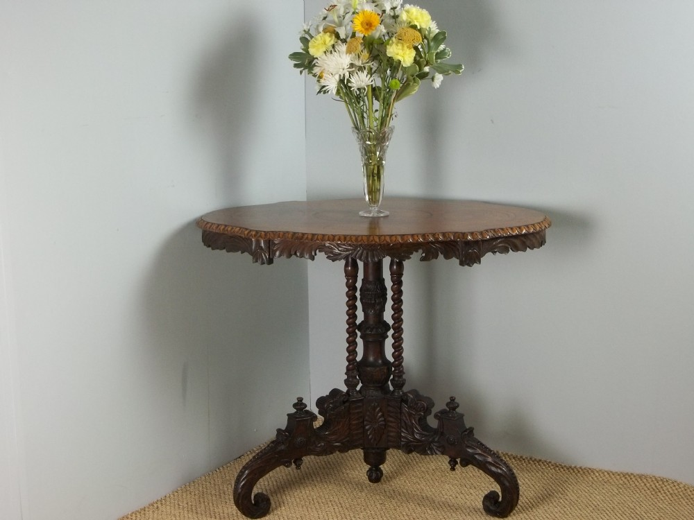 a 19th century walnut marquetry inlaid oval serpentine shaped black forest centre lamp occasional hall center tripod sofa side table c1870