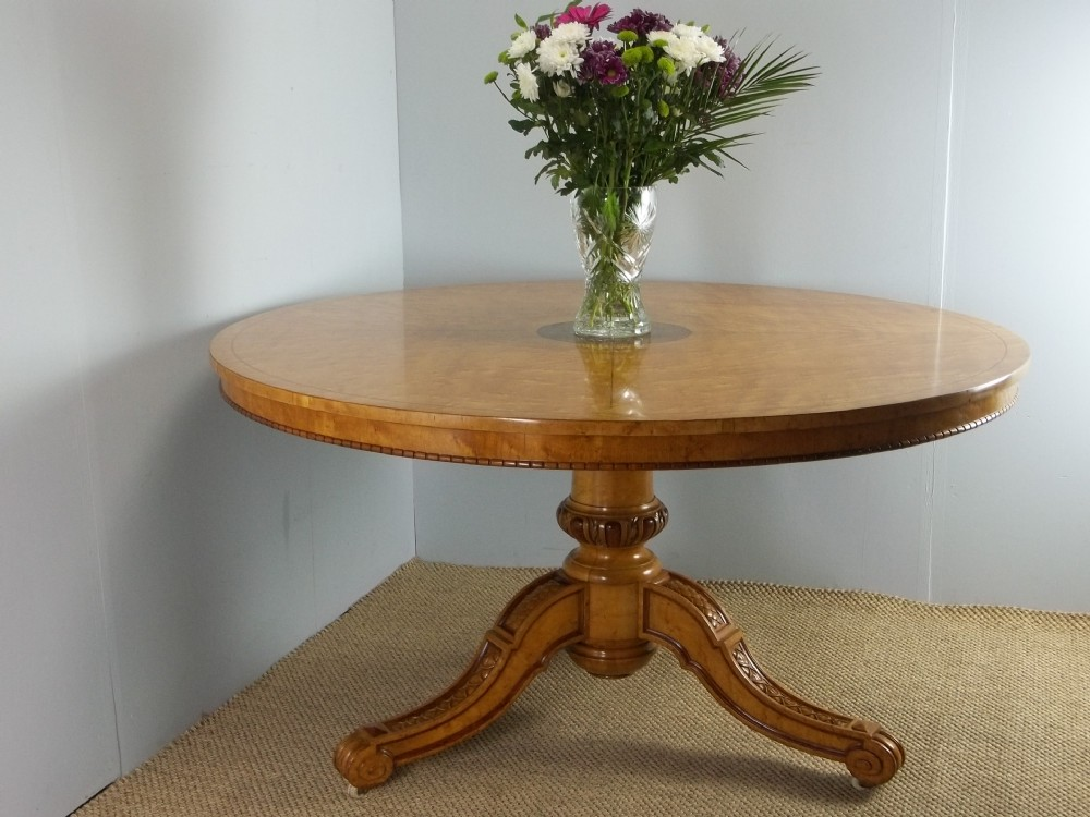 a fine and rare antique georgian regency circular round inlaid centre center dining table in birds eye maple and padouk attributed to gillows c1825
