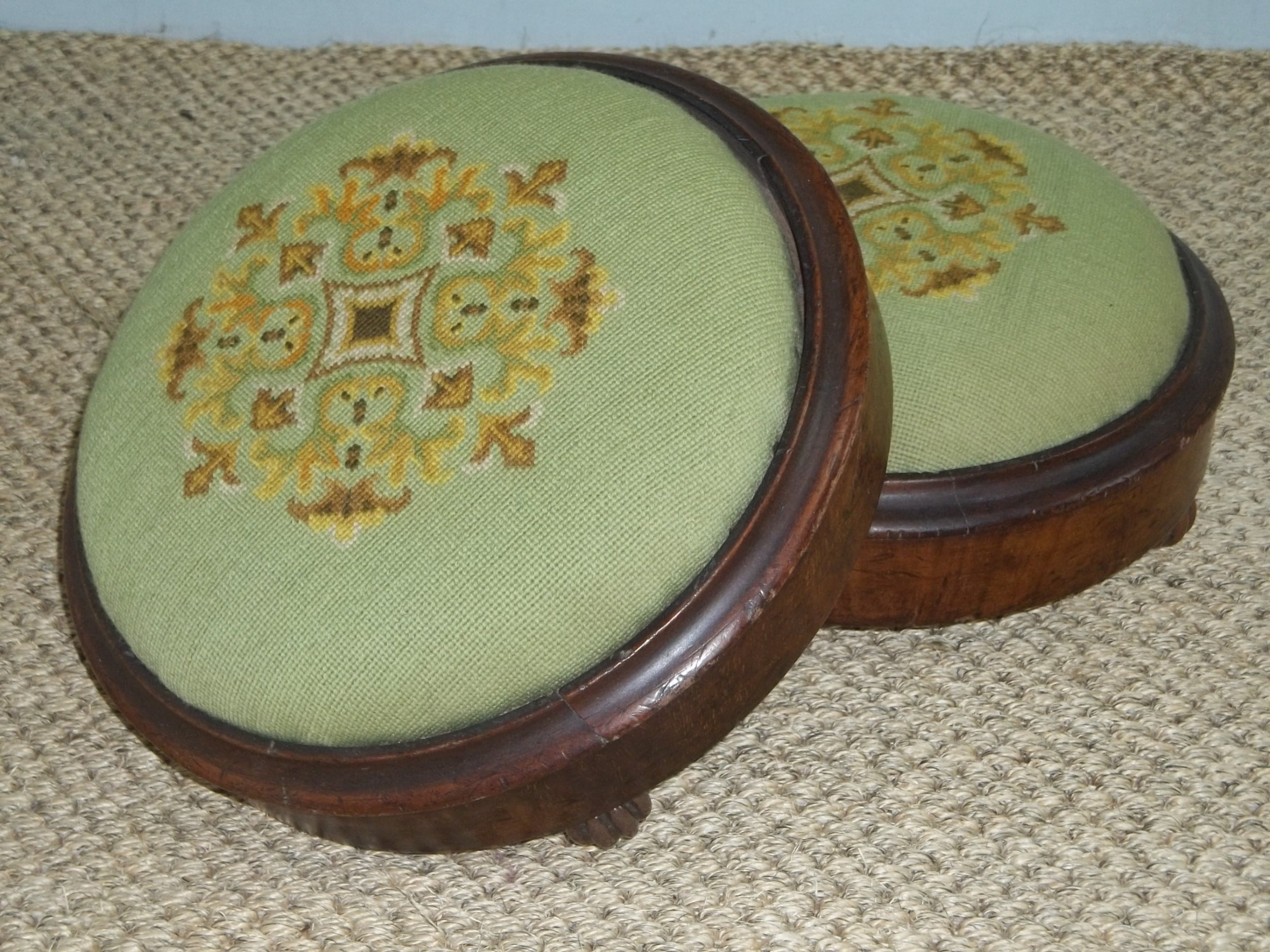 antique pair of walnut petit point tapestry upholstered circular small gout foot stools