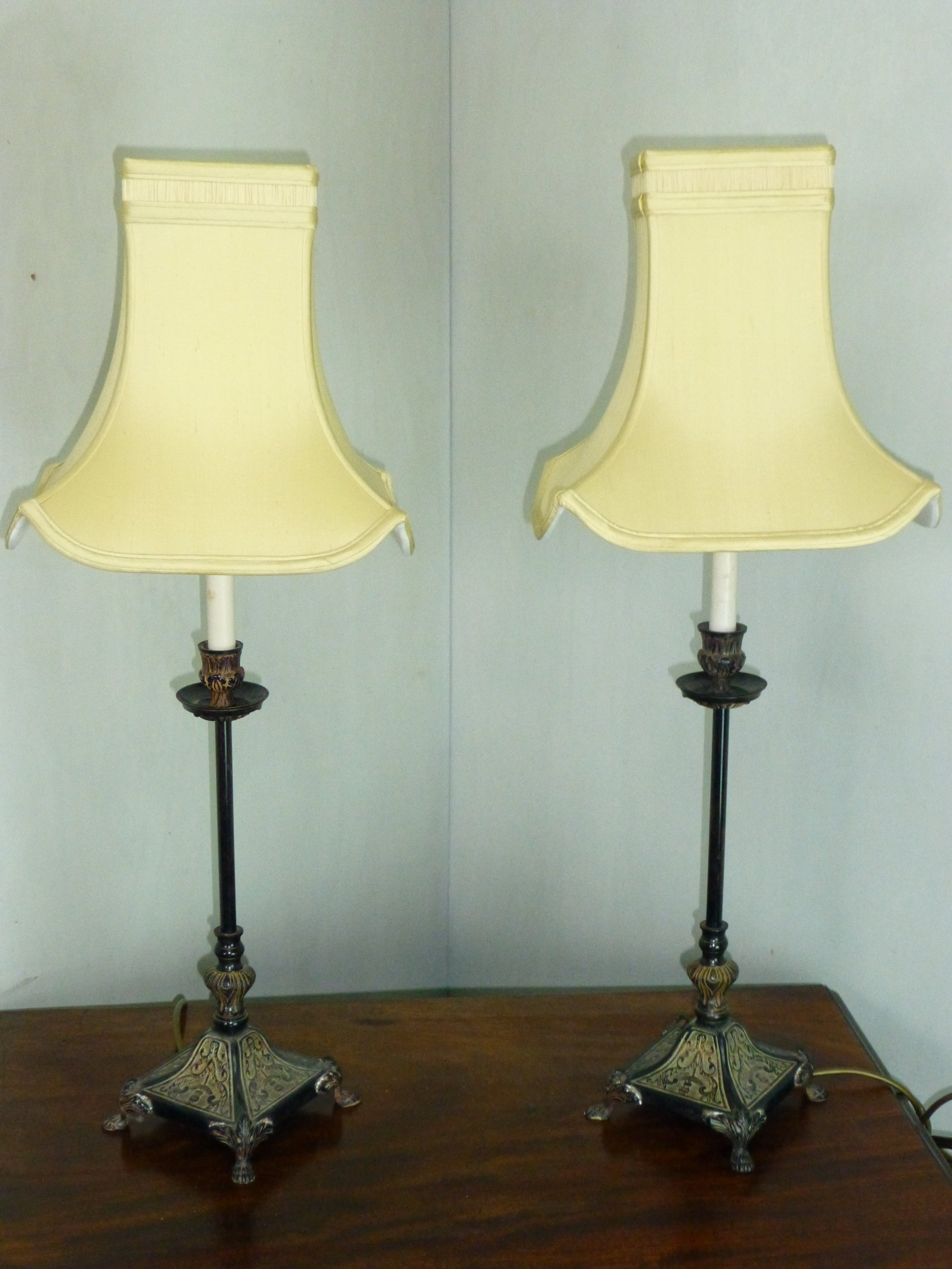 a pair of early 20th century bronzed table lamps