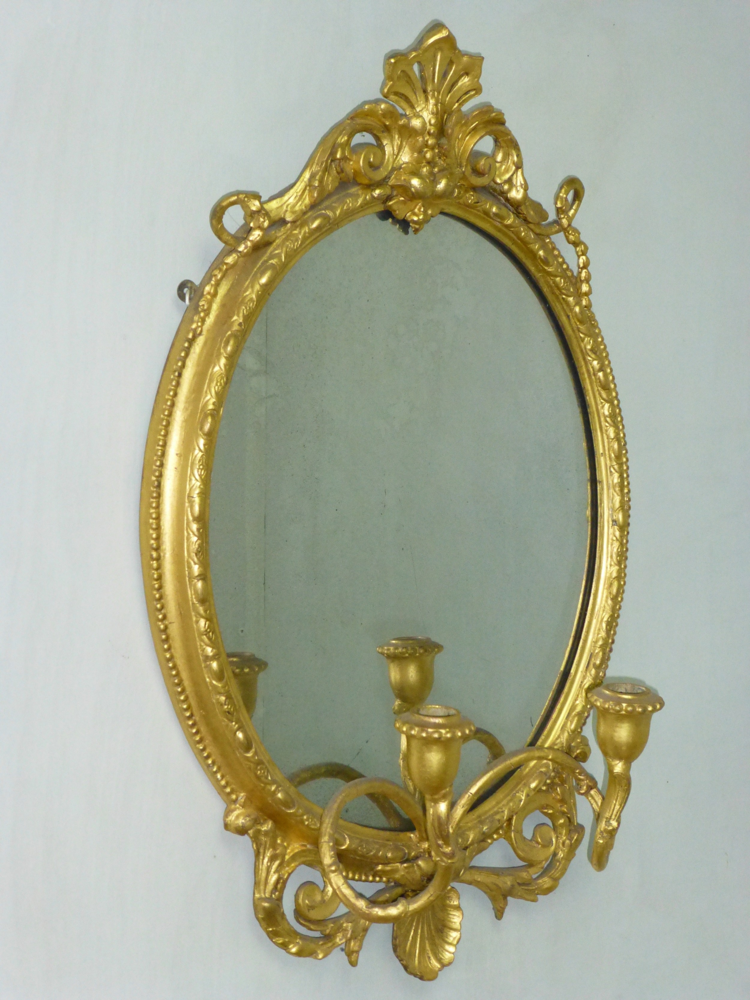 a good quality gilt wood and composition 19th century girandole oval mirror c1860