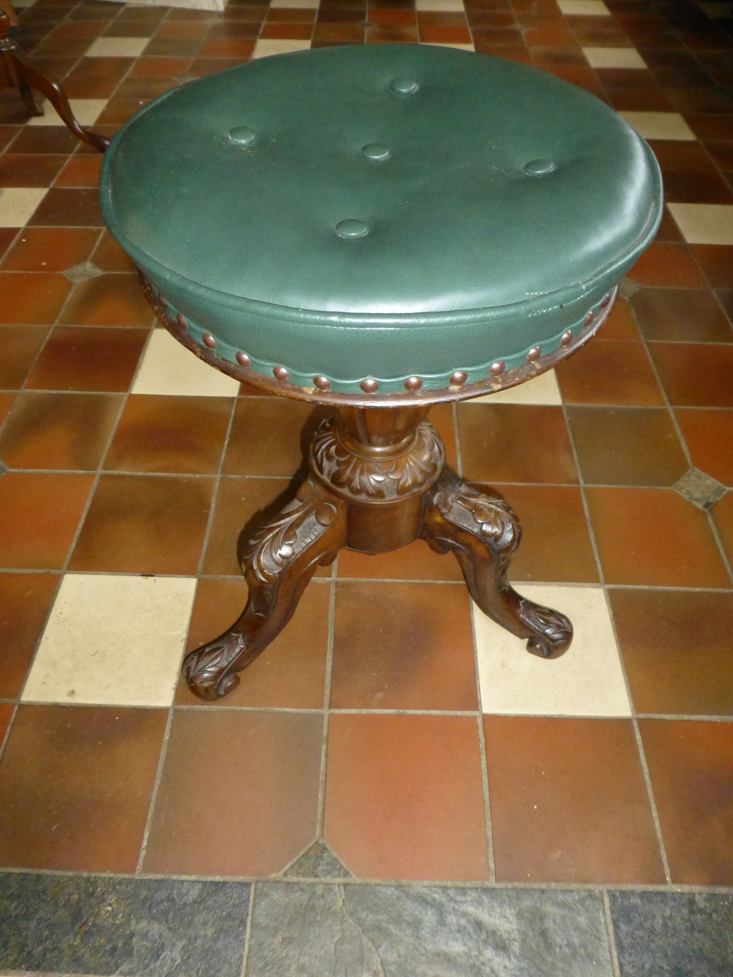 19th century leather upholstered revolving walnut piano stool