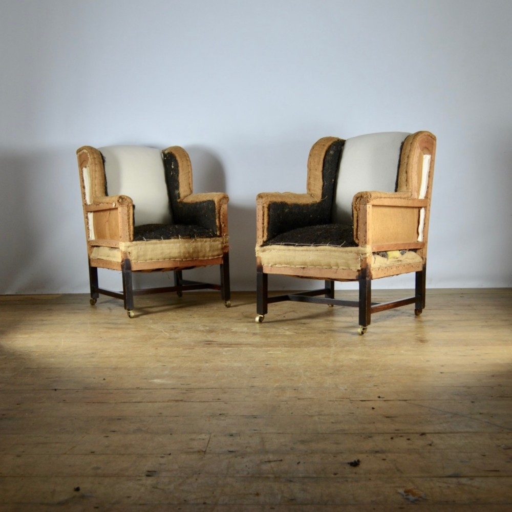 pair of english winged armchairs full reup inc