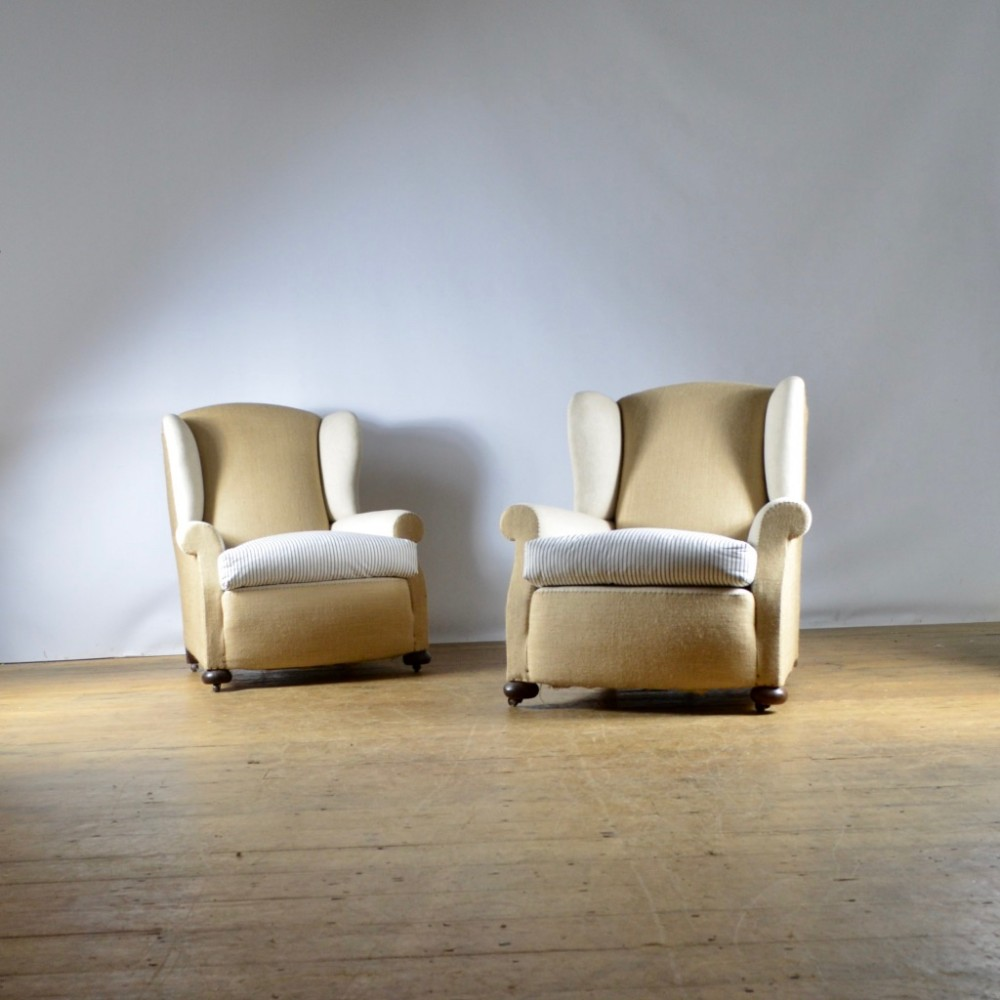 pair of winged armchairs full reupholstery inc