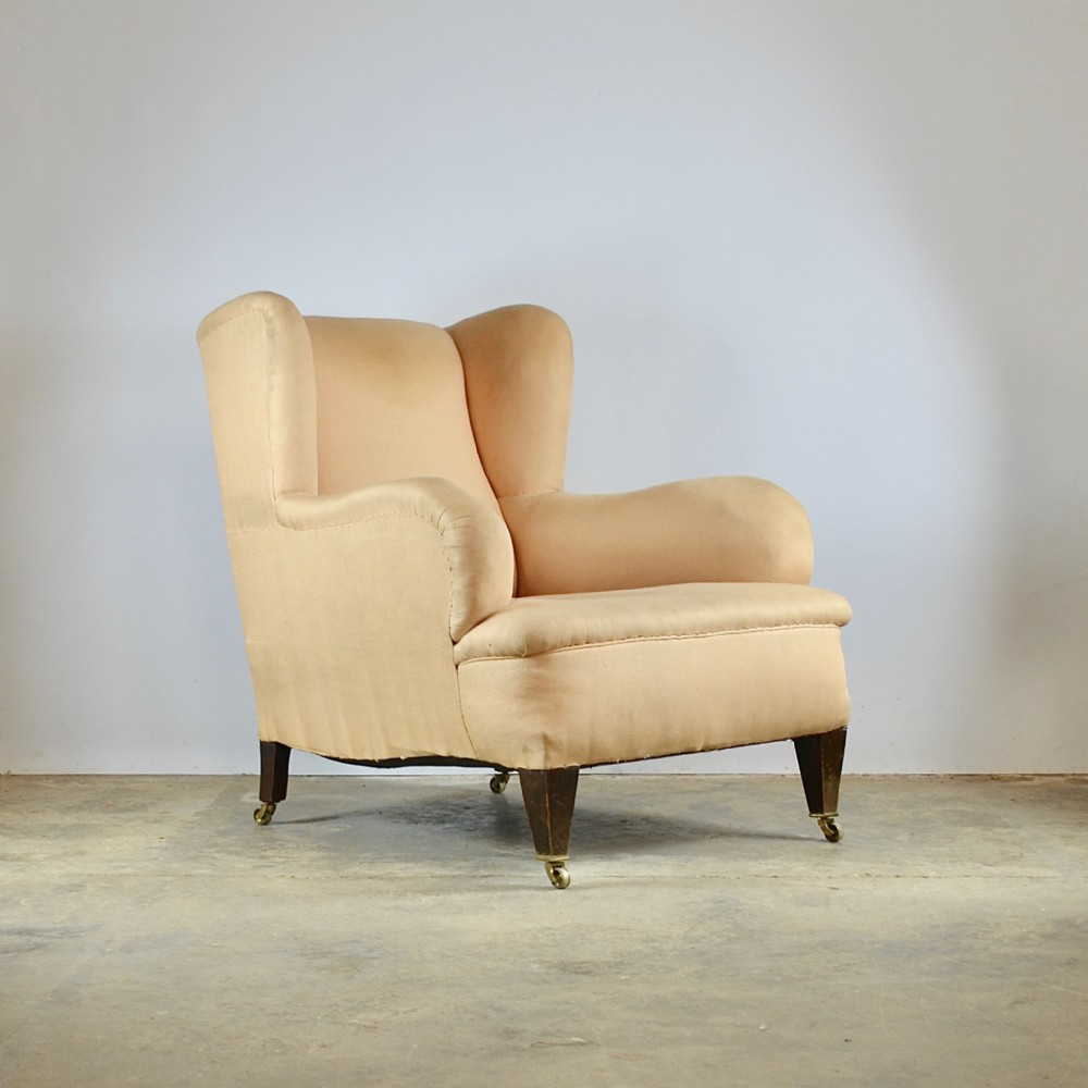 large deep seated winged armchair