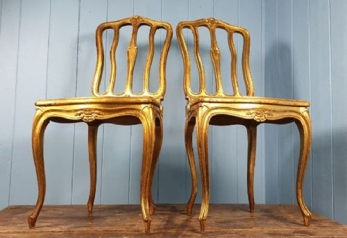 rare pair of louis xv gilded salon chairs with cane seating