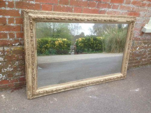 a large highly decorative early antique 19th century french original carved wood gesso distressed gilt mirror