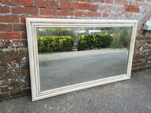 a good size antique 19 th century french carved wood painted plain mirror