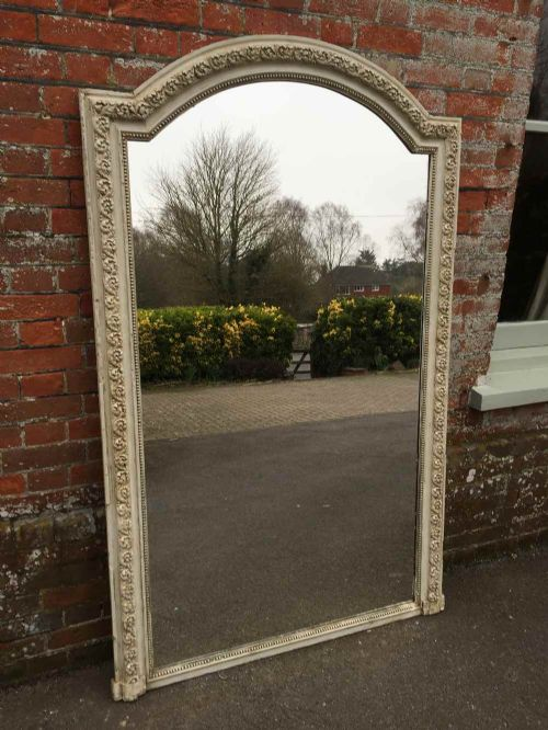 a large shaped top antique 19th century french carved wood and gesso painted mirror
