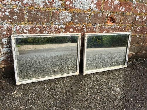 a very unusual pair of antique 19th century french carved wood original painted mirrors