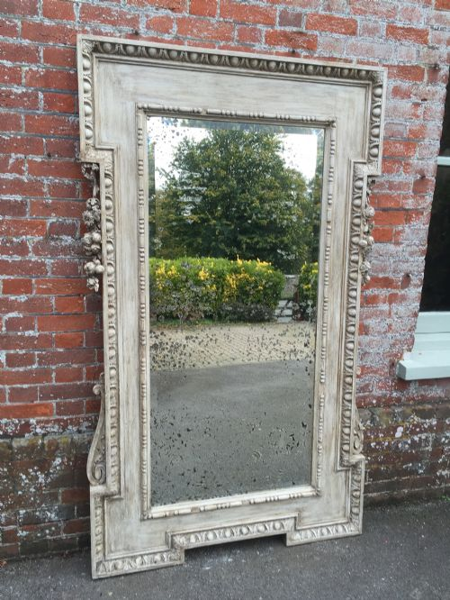 an absolutely stunning large antique 19th century carved wood and gesso painted french shaped mirror