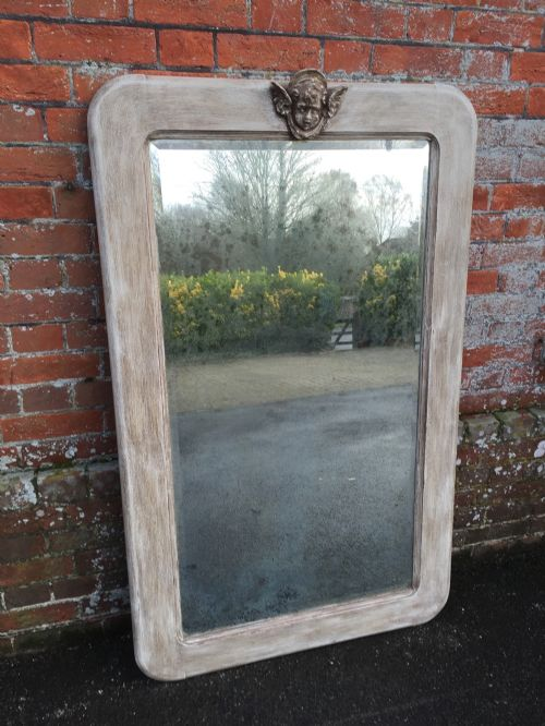 a highly unusual antique 19th century french carved wood painted plain curved framed mirror
