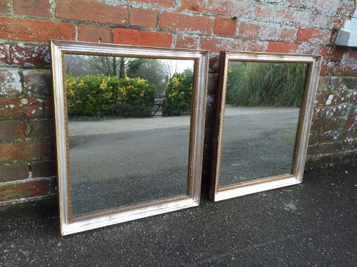 a very useful pair of antique 19th century french silver gilt mirrors