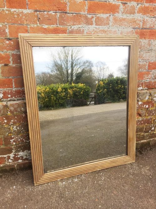 a very useful size early antique 19th century french carved wood gesso original gilt ribbed bistro mirror