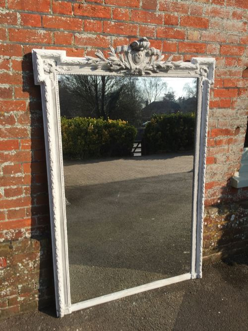 a fabulous large antique 19th century french carved wood gesso painted shaped top mirror