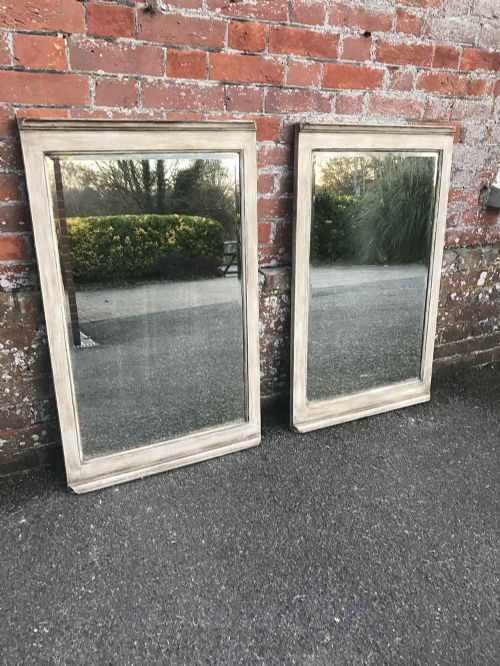 an unusual pair of antique 19 th century french carved wood painted mirrors