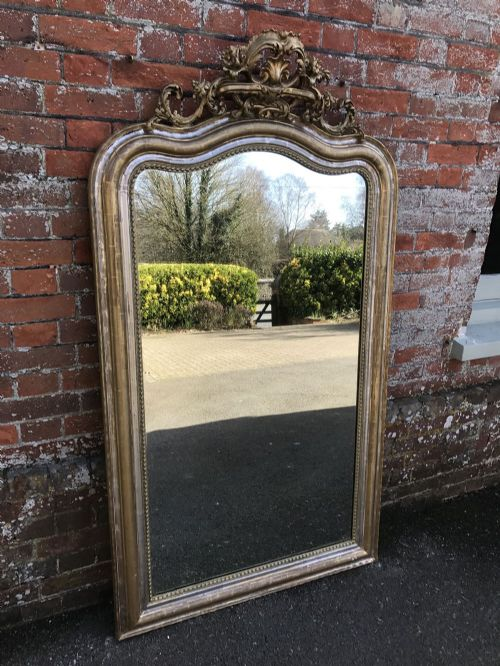 a superb large antique 19th century french carved wood gesso original shaped top silvered and gilt mirror