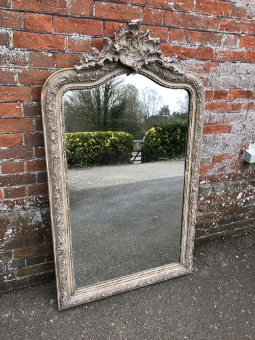 a wonderful antique 19th century french carved wood gesso painted distressed shaped top crested mirror