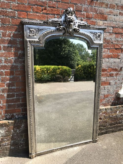 an absolutely stunning large antique 19th century french carved wood gesso original silvered shaped top mirror