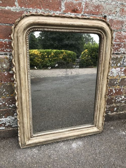 a useful 19th century antique french distressed painted pie crust mirror
