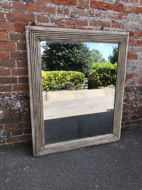 a superb early antique 19th century french carved wood gesso painted ribbed mirror