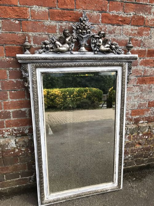 a highly decorative antique 19th century french carved wood gesso original silvered and painted mirror