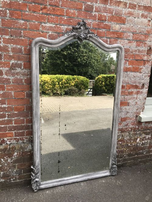 an exquisite large antique 19th century french carved wood painted shaped top mirror