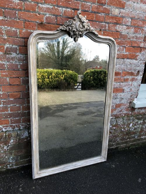 a spectacular large antique 19th century french carved wood and gesso painted shaped top mirror