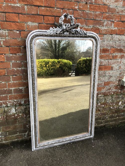 an exquisite large antique 19th century french carved wood and gesso silvered and painted arched top mirror