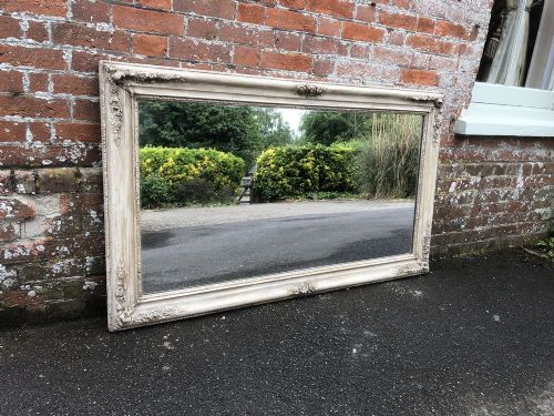 a very useful antique 19th century french carved wood and gesso painted mirror