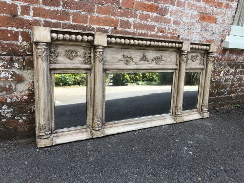 a superb early 19th century english carved wood and gesso triple plate column overmantle mirror