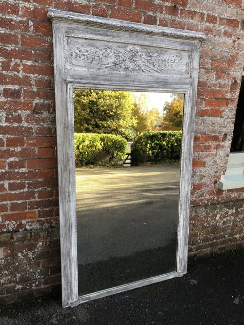 a delightful large antique 19th century french carved wood gesso painted trumeau mirror
