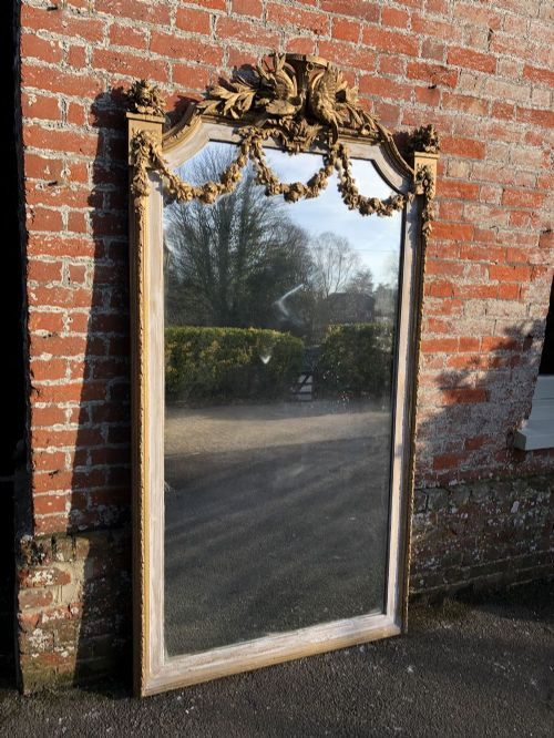 a spectacular large antique french carved wood gesso orignal gilt and painted mirror