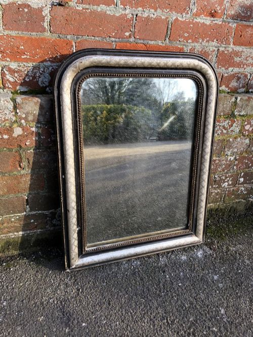 a good size antique french 19th century arched top original silver and black mirror