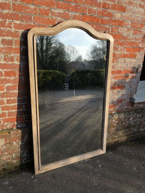 a stunning large antique french carved wood painted plain shaped top mirror