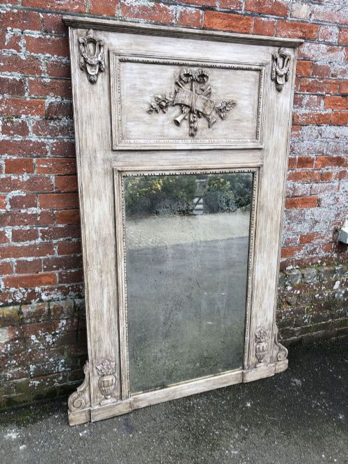 an absolutely stunning large antique 19th century french carved wood painted gilt shaped top mirror