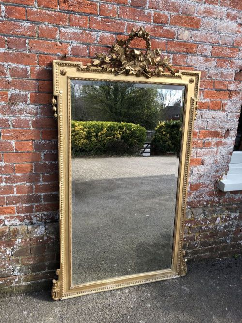 an exceptional large antique french carved wood gesso original gilt mirror