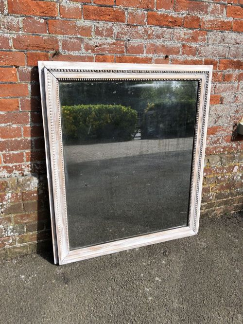 a delightful antique french carved wood distressed painted ribbed framed mirror