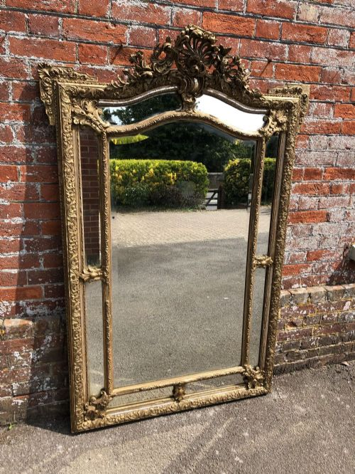 a superb large antique french 19th century wood gesso original silvergilt distressed shaped top cushion mirror