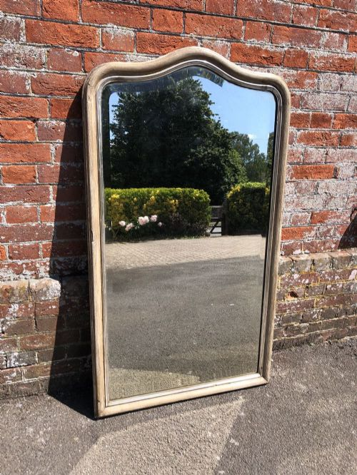 a stunning good size antique french 19th century carved wood gesso shaped top original silvered and painted mirror