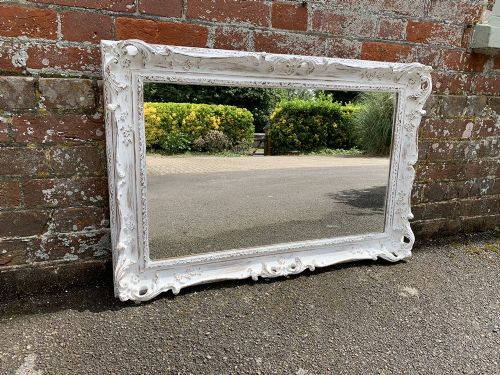 a wonderful good size early 20th century english carved wood painted mirror