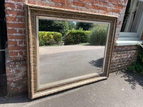 a spectacular large antique 19th century english carved wood and gesso original silvergilt distressed mirror