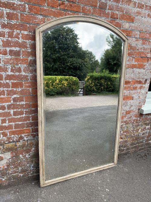 a delightful large antique 19th century french carved wood painted shaped top plain mirror