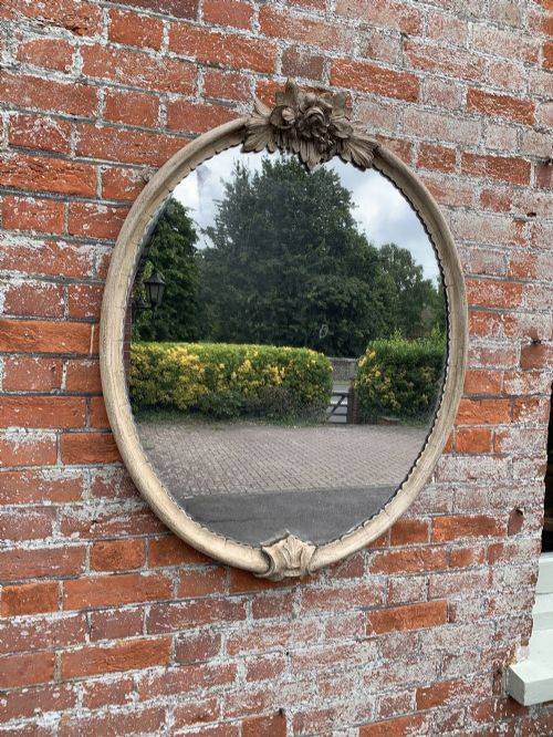a superb good size antique 19th century french carved wood painted oval mirror