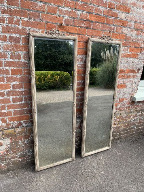 a spectacular highly unusual pair of antique 19th century french carved wood gesso painted ribbed framed pier mirrors