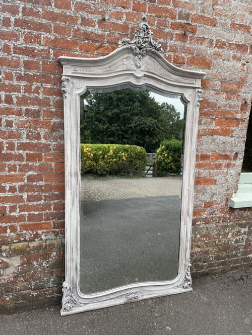 a superb large antique 19th century french carved wood painted shaped top mirror